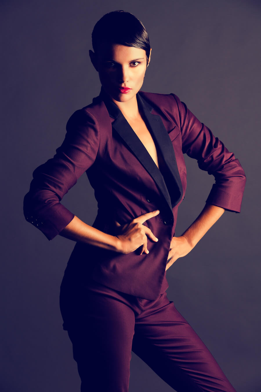 Gorgeous maroon suit with model for fashion shoot