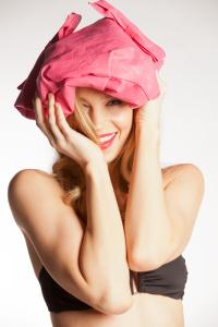 Roxana Redfoot having fun with purse on her head