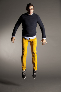 Male model jumping up in yellow pants
