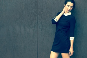 Taylor Hintze against metal wall for fashion shoot