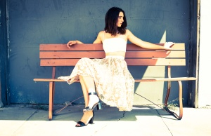 Taylor Hintze from the Clutts Agency sitting on bench for fashion photo shoot