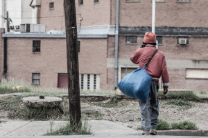 Only Temporary - Homeless in Dallas: Man walking across the street