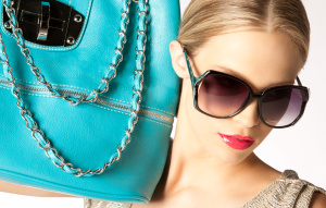 Roxana Redfoot beauty shot with teal purse
