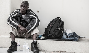 Only Temporary - Homeless in Dallas: Older man and his belongings