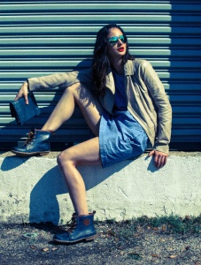 Premela Dove sporting leather with denim dress and purse for fashion shoot